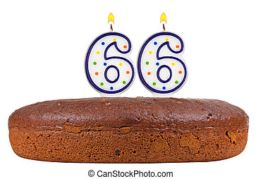 birthday cake with candles number sixty six isolated on...