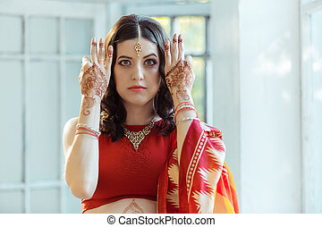 Indian picture on woman hands, mehendi tradition decoration...