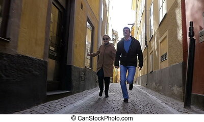 Happy run together in old city street - Slow motion...