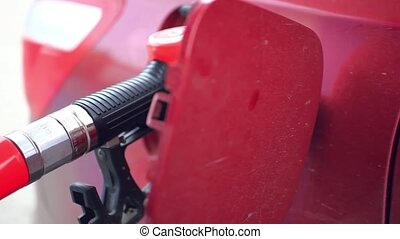 Car refueling on a petrol station. - Car fueling at the gas...