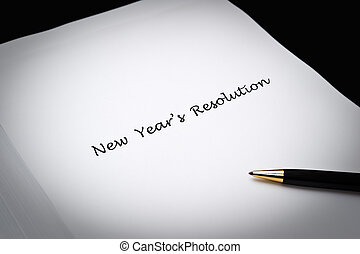New Year\'s Resolution - Writing new year\'s resolutions on...