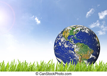 Planet Earth on beautiful green grass and sunny day with...