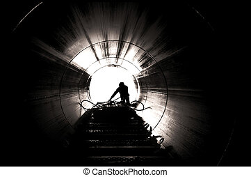 Industrial worker silhouette - Image from inside tube...