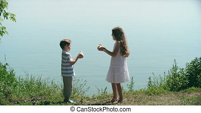 Letting Doves of Peace Fly - Little girl and boy setting...