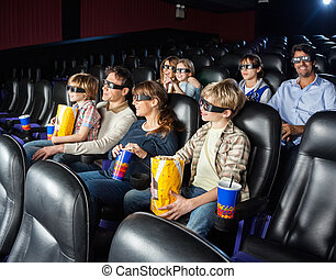 Families Watching 3D Movie In Cinema Theater
