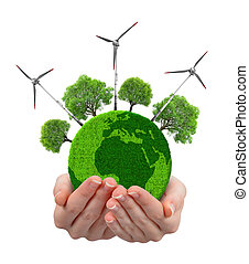Green planet with trees and wind turbines in hands