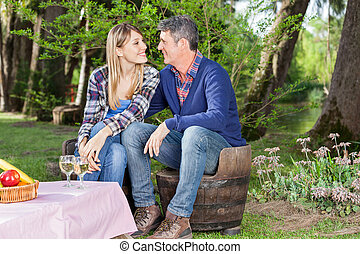 Couple Looking At Each Other At Campsite
