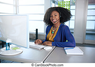 Portrait of a smiling customer service representative with...
