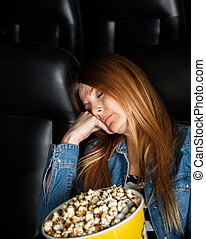 Bored Woman Sleeping At Cinema Theater - Bored woman with...
