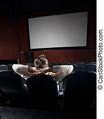 Relaxed Man Watching Movie In Theater