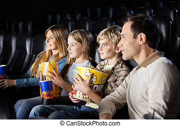 Family Watching Film In Theater