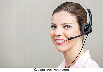 Female Employee Wearing Headset At Call Center - Portrait of...