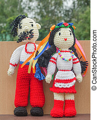 Dolls. Knitted toys and souvenirs. The bride and groom, in...