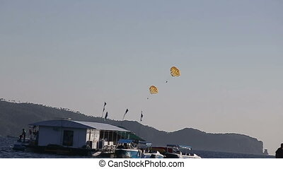 Parachute flying over the ocean - Paraglider is lifting off...