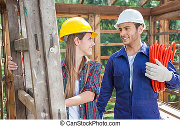 Smiling Workers At Construction Site