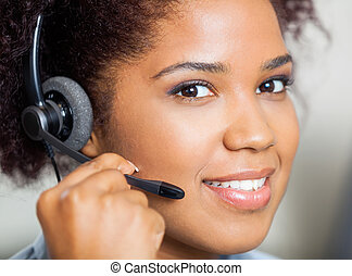 Smiling Female Customer Service Representative Wearing Headset