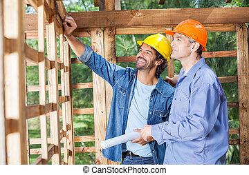 Happy Architects Discussing At Construction Site