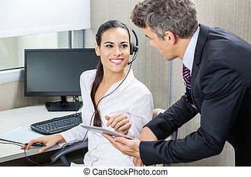 Manager And Customer Service Representative Discussing In Office