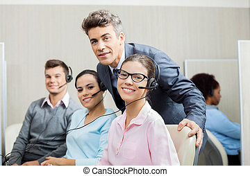 Manager With Team In Call Center - Portrait of confident...