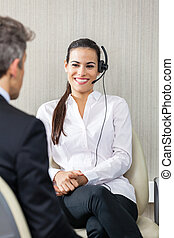 Female Customer Service Agent Looking At Manager - Happy...
