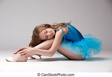 Pretty little dancer posing with eyes closed - Pretty little...
