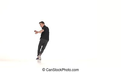 Young, stylish man continue doing brake dancing movements, on white, slow motion