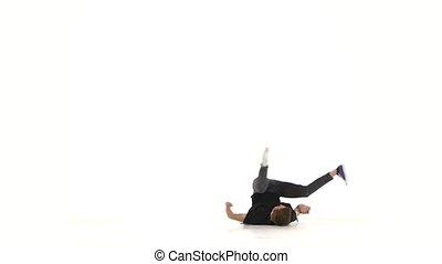 Modern dancer dancing brake-dance on white, slow motion