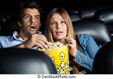Shocked Couple Watching Movie In Theater