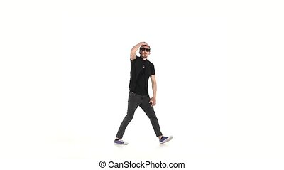 Hip hop style dancer performing, on a white background, slow...