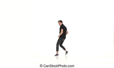 Modern dancer dancing brake-dance on hands, white, slow...