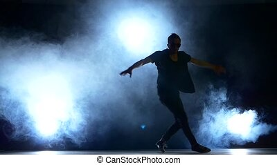 Young hiphop dancer starts making a move, smoke, silhouette,...