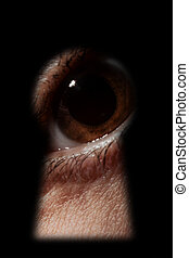 male eye spying through a keyhole - Scared male eye spying...