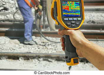 Recording with Infrared camera Two Workers with pneumatic...