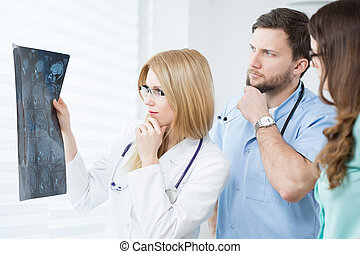 Afraid physicians - Two young afraid physicians checking...