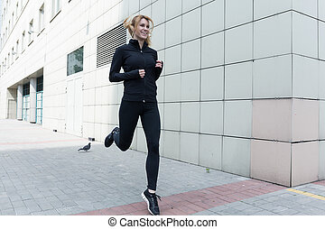 Lady keeping fit - Image of a young slim lady keeping fit