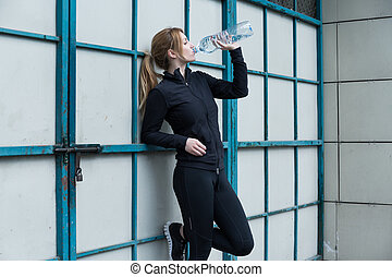 Runner holding a bottle
