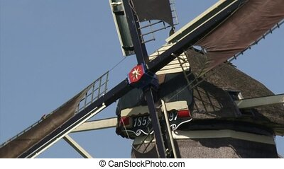 Dutch Windmill in operation - close up windshaft, beard +...
