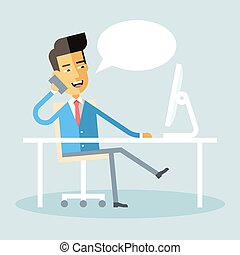 Asian manager sitting at desk and talking on phone
