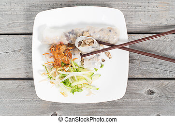 Banh cuon, Vietnamese steamed rice noodle rolls on a wooden...