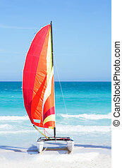 Catamaran with its colorful sails wide open on cayo Santa...