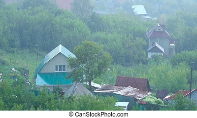 Summer rain - The village in the rain, aerial view, slow...