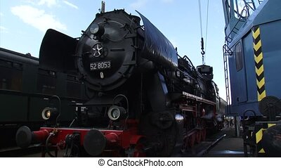 Loading a steam locomotive with coal. Locomotive 52 8053...