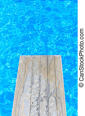 Swimming pool with old wooden diving board
