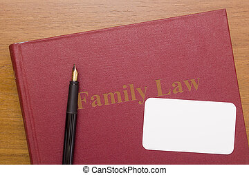 Family law - book and fountain pen with a clean business...