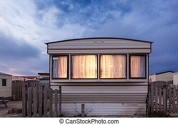 Mobile home on a trailer park at dusk - Old vacation home...