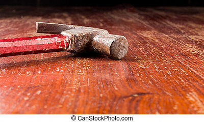 Close up of hammer on wooden table with copy space