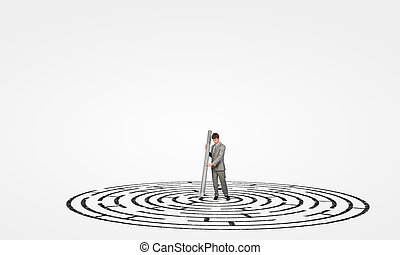 Businessman drawing maze - Young businessman drawing maze on...