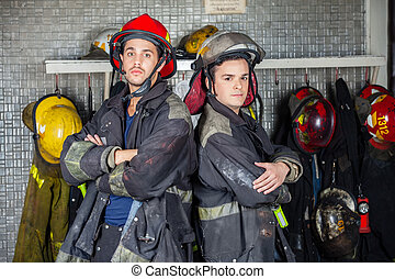 Confident Firefighters Standing Arms Crossed - Portrait of...