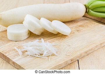 Daikon radishes,Raphanus sativus L on table wood background.