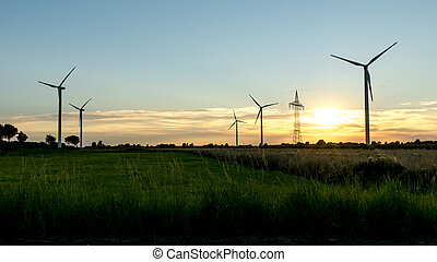 Windfarm - Silhouette of Wind Turbines in the evening Light